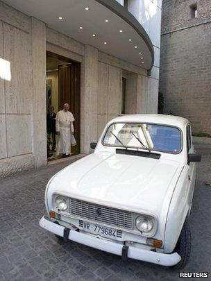 Pope Francis is presented with a Renault 4 car during a private audience with Don Renzo Zocca at the Vatican in this picture taken on 7 September 2013