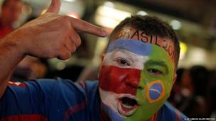 A fan celebrates the Costa Rican football team's qualification for the 2014 World Cup