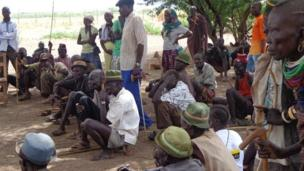 Community members from Nadapal village in Kakuma discuss on planned drilling of wells, Kenya