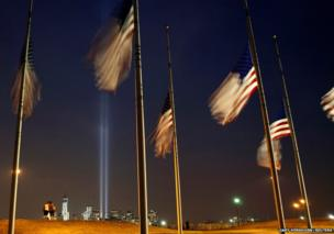 The Tribute in Light is illuminated next to One World Trade Center