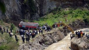 Members of the public prosecutor's office and rescuers at the site of a bus accident