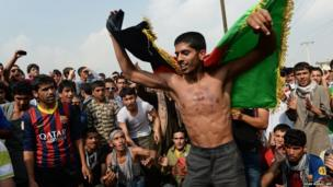 Football fans in Afghanistan celebrate victory