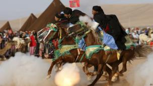 Rider perform the traditional Fantasia at the Moussem festival in Tan Tan, southern Morocco – 7 September 2013