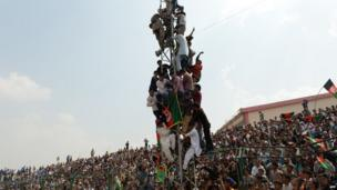 Afghans watch their national football team as they celebrate victory in the South Asian Football Federation Championship, at the Kabul stadium on 12 September 2013.