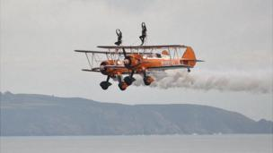 The wingwalkers at the Guernsey Air Display 2013 in front of Herm