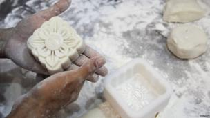 A man prepares moon-cakes at a traditional confectionery for the upcoming Mid-Autumn Festival in Hanoi.