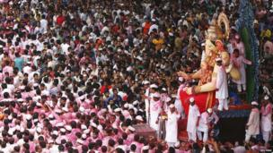 Devotees carry an idol of Hindu elephant god Ganesh, the deity of prosperity, during a procession through the streets