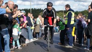 A rider climbs Caerphilly Mountain