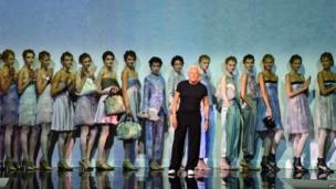 Giorgio Armani and models at Milan fashion week, 20 September 2013