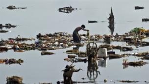 Man scavenging in the Yamuna River, New Delhi, 20 September, 2013