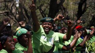 Cheering supporters of President Robert Mugabe in Harare, Zimbabwe, Tuesday 17 September 2013