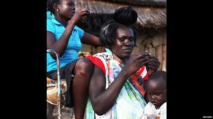 Women in Abyei, which borders Sudan and South Sudan, plait their hair - Friday 13 September 2013
