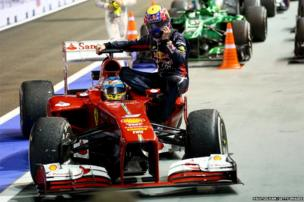 Mark Webber of Australia and Infiniti Red Bull racing is given a lift back to pits by Fernando Alonso of Spain and Ferrari