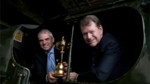 2014 Ryder Cup captains Paul McGinley of Europe and Tom Watson of the USA pose with the Ryder Cup trophy on a steam locomotive
