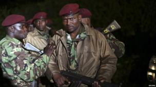 Kenyan soldiers are pictured near Nairobi's Westgate shopping centre on Monday September 23 as the siege continues for a third night.