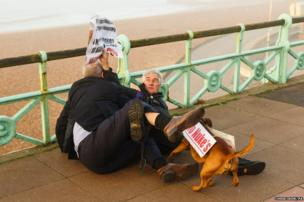 Iain Dale scuffles with a protester