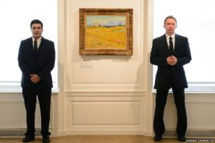 Security guards stand with Wheat Field by Vincent Van Gogh
