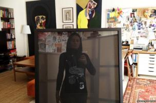 Woman reflected in picture frame