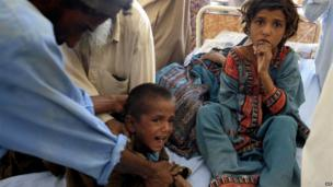 Children treated at a makeshift hospital in Awaran on 25 September 2013