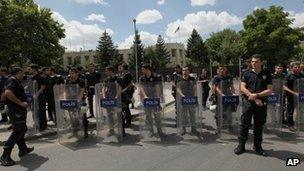 Riot police stand guard outside the US embassy in Ankara, Turkey on 27 July 2013