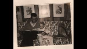 Richard Scarry, reading with his son Huck
