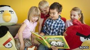 Children reading Angry Birds Playground book