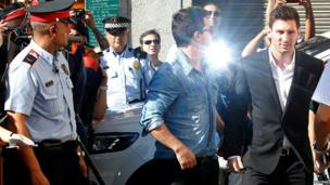 Barcelona forward Lionel Messi, right, arrives at a court in Spain to answer tax fraud charges.