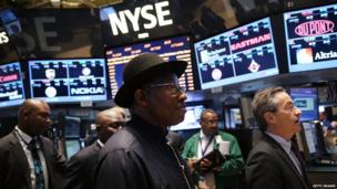 Nigerian President Goodluck Jonathan walks on the floor of the New York Stock Exchange