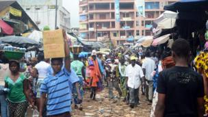 People walking in a street of Conakry, Guinea's capital, on Tuesday