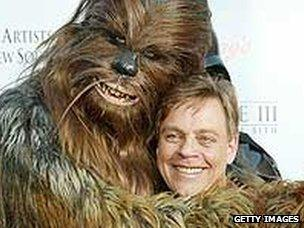 Actor Mark Hamill, who played Luke Skywalker in the original Star Wars trilogy with Chewbacca