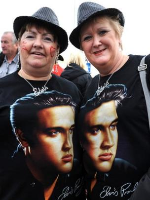 Two women at the Elvis festival wearing T shirts with the star