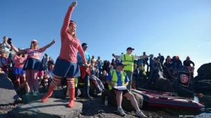 A competitor takes part in the World Stone Skimming Championships