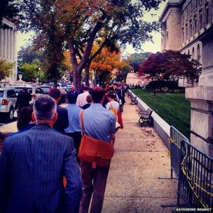 Government staff wait in a queue in Washington DC on the first shutdown day. Photo: Katherine Brandt.
