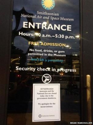 A closure sign hangs on the door of the Smithsonian National Air and Space Museum. Photo: Brian Marcoullier.