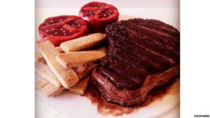Steak, chips and tomoates made out of cake