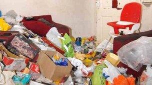 The rubbish-strewn living room in Amanda Hutton's house