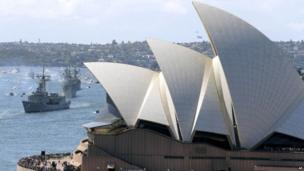 Australian warships from front, HMAS Sydney, Darwin and Perth sail towards the Opera House as they enter the harbour in Sydney