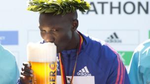 Kenyan runner Wilson Kipsang sipping a beer, Berlin, Germany - Sunday 29 September 2013