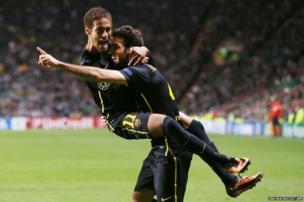 Barcelona's Spanish midfielder Cesc Fabregas (right) celebrates with Brazilian striker Neymar