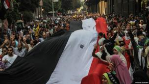 Supporters of President Morsi march in Cairo streets on the 40th anniversary of Arab-Israeli war