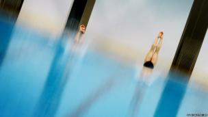 of North Korea compete before winning the bronze medal in the Men's diving