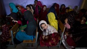 Afghan refugee girls attend an English language class, at a makeshift school on the outskirts of Islamabad, Pakistan