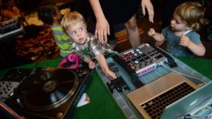In New York a toddler takes part in a Baby DJ School class