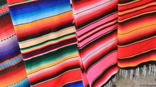 Brightly coloured lines on Mexican blankets