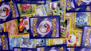 A pile of Pokemon cards.
