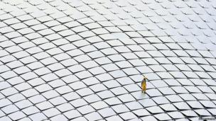 A worker inspecting the rooftop of a theatre in Singapore