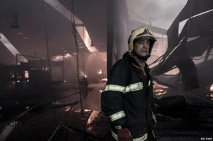 Firefighters putting out a factory fire in Portugal.