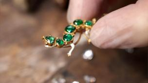 The Salamander brooch set in gold with emeralds and diamonds