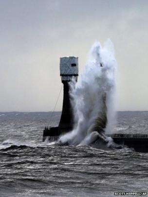 Heavy seas and waves crash over Roker pier at Sunderland, England