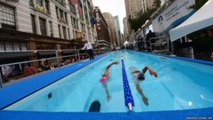 Long distance swimmer Diana Nyad (left) takes part in Swim for Relief